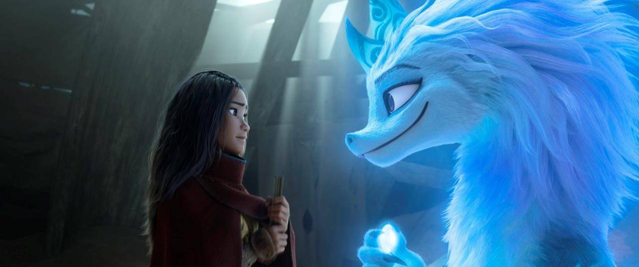 """Animated character Raya, voiced by Kelly Marie Tran, left, appears with Sisu the dragon in a scene from """"Raya and the Last Dragon."""" THE CANADIAN PRESS/Disney+ via AP"""