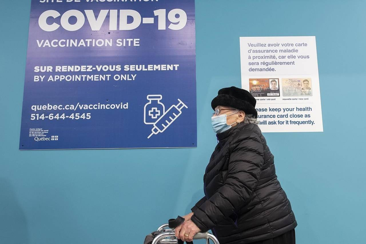 Elvira D'Angelo, 92, waits to receive her COVID-19 vaccination shot at a clinic in Montreal, Sunday, March 7, 2021, as the COVID-19 pandemic continues in Canada and around the world. THE CANADIAN PRESS/Graham Hughes