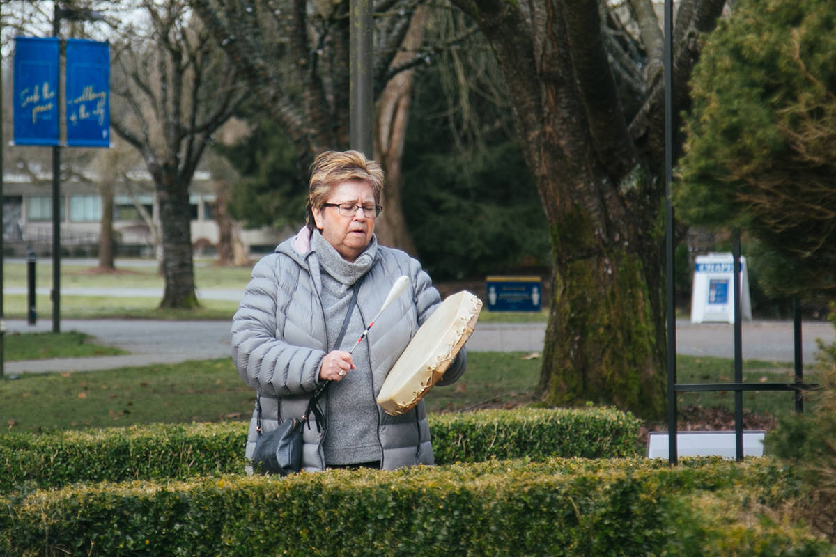 Patricia Victor offered prayer songs in Halq'eméylem, the language of the Stó:lō people at Trinity Western University in Langley. On Monday, March 8, 2021, International Women's Day, TWU opened an outdoor story walk created by Victor. (Cheyanne Makelki/TWU)