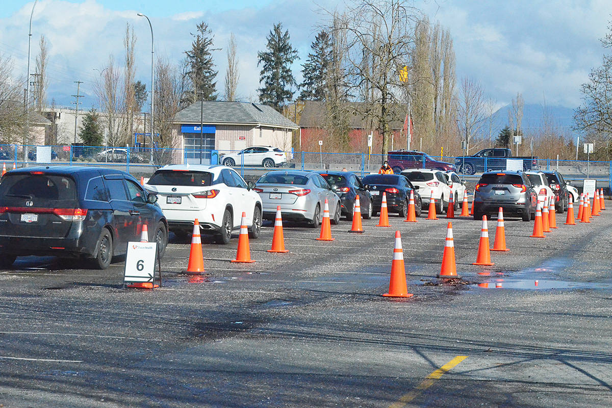 Vehicles lined up at the testing clinic at KPU's Langley parking lot on Wednesday, Feb. 17. The site is also giving vaccinations to seniors 90 and over starting next week. (Langley Advance Times files)