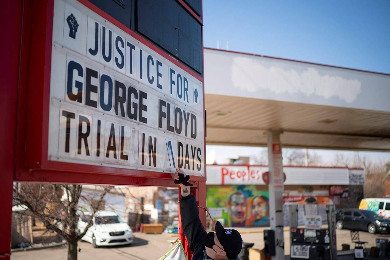 "Billy Briggs, who lives just 170 steps from where George Floyd was killed, created and maintains the countdown sign at the gas station on the corner of George Floyd Square in Minneapolis, Minn. On Sunday, the eve of the trial date, he updated it to ""1"". (Jeff Wheeler /Star Tribune via AP)"