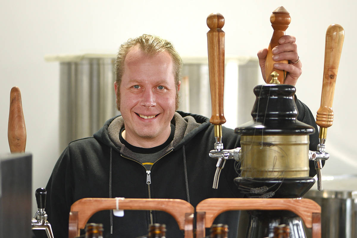 Howl Brewing brewer and co-owner Daniel van Netten stands at the taps inside his very small brewery.  Don Denton photo
