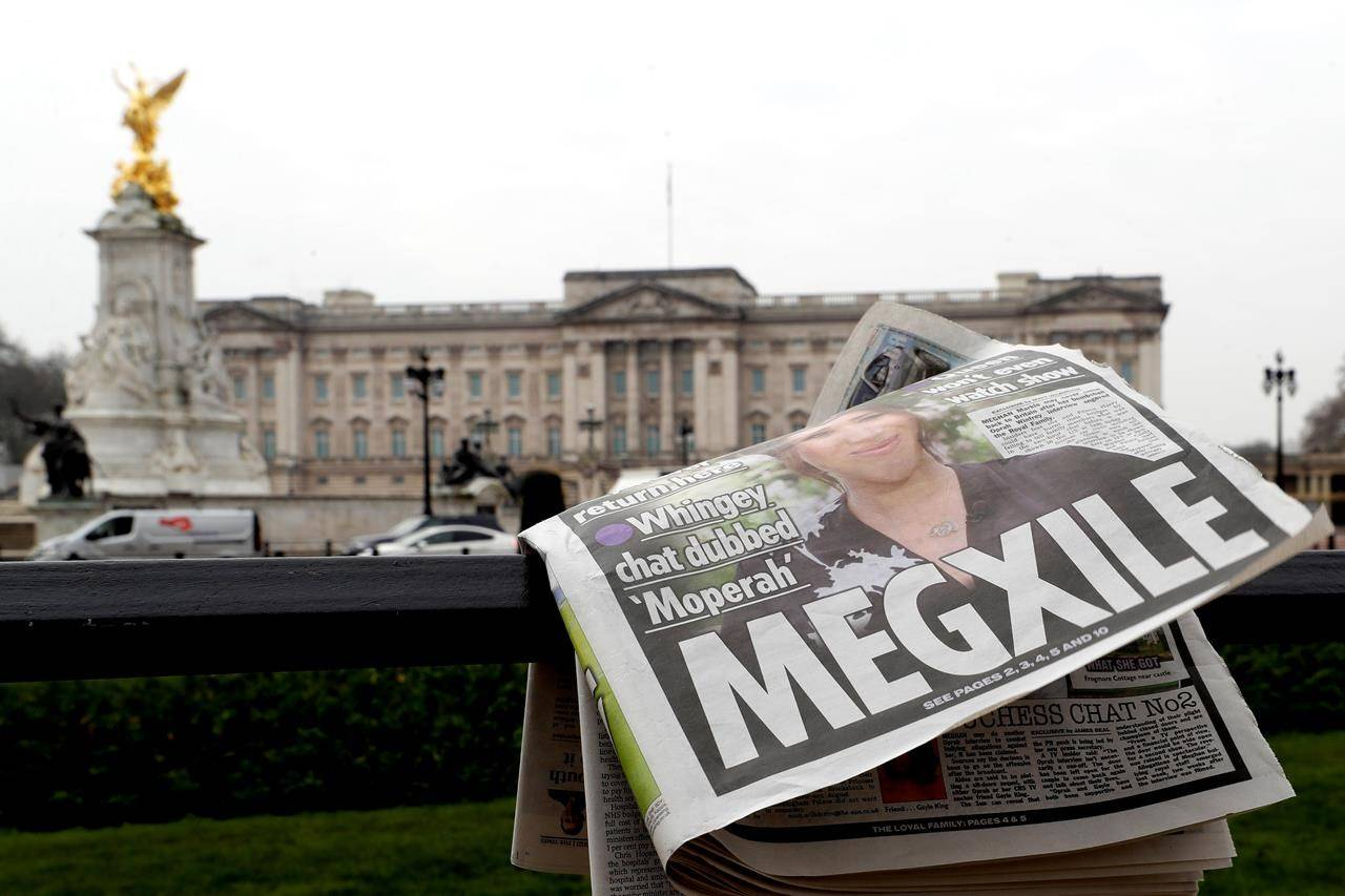 A newspaper is blown by the wind after it is placed on a railing by a television crew outside Buckingham Palace in London, Monday, March 8, 2021. Britain's royal family is absorbing the tremors from a sensational television interview by Prince Harry and the Duchess of Sussex, in which the couple said they encountered racist attitudes and a lack of support that drove Meghan to thoughts of suicide. THE CANADIAN PRESS/AP, Kirsty Wigglesworth