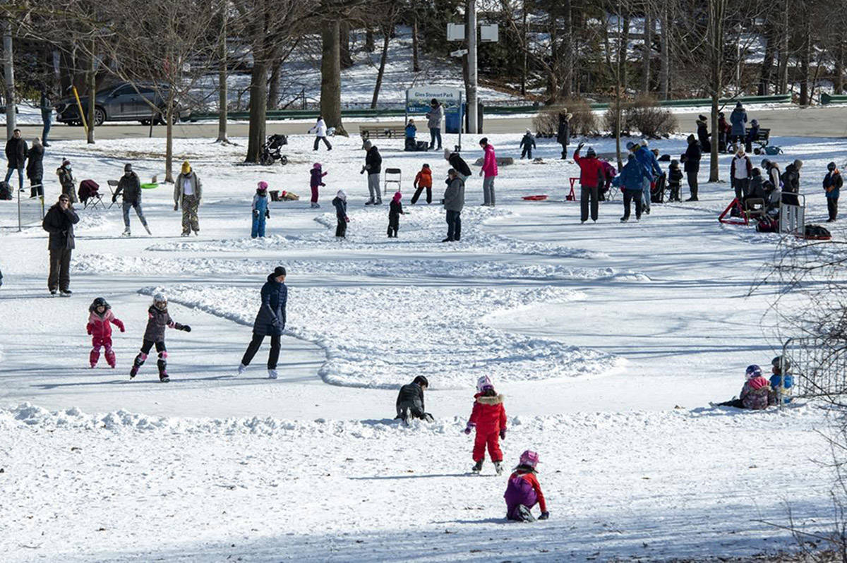 Parents and children enjoy Family Day as they take to the ice on a home made ice rink in a city park in Toronto, Monday, Feb. 15, 2021. Restrictions meant to stem the spread of COVID-19 are easing in parts of Ontario and Quebec and all of New Brunswick. THE CANADIAN PRESS/Frank Gunn