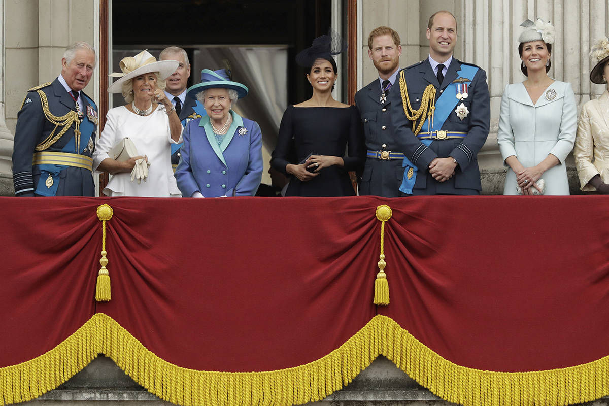 FILE – In this Tuesday, July 10, 2018 file photo, members of the royal family gather on the balcony of Buckingham Palace, with from left, Britain's Prince Charles, Camilla the Duchess of Cornwall, Prince Andrew, Queen Elizabeth II, Meghan the Duchess of Sussex, Prince Harry, Prince William and Kate the Duchess of Cambridge, as they watch a flypast of Royal Air Force aircraft pass over Buckingham Palace in London. (AP Photo/Matt Dunham, File)
