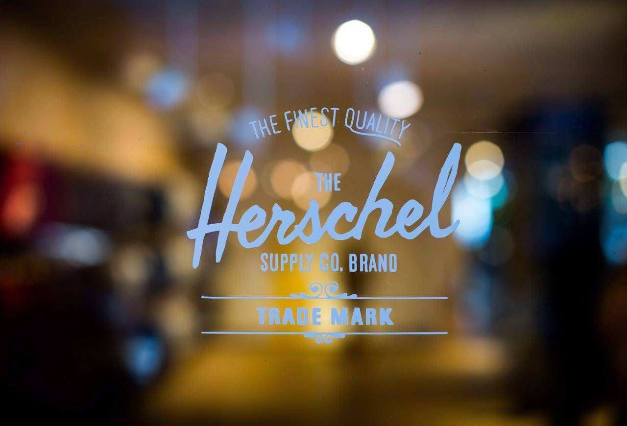 A Herschel Supply Company logo is seen on a door at the company's new flagship and first North American store, in Vancouver, on Monday June 11, 2018. THE CANADIAN PRESS/Darryl Dyck