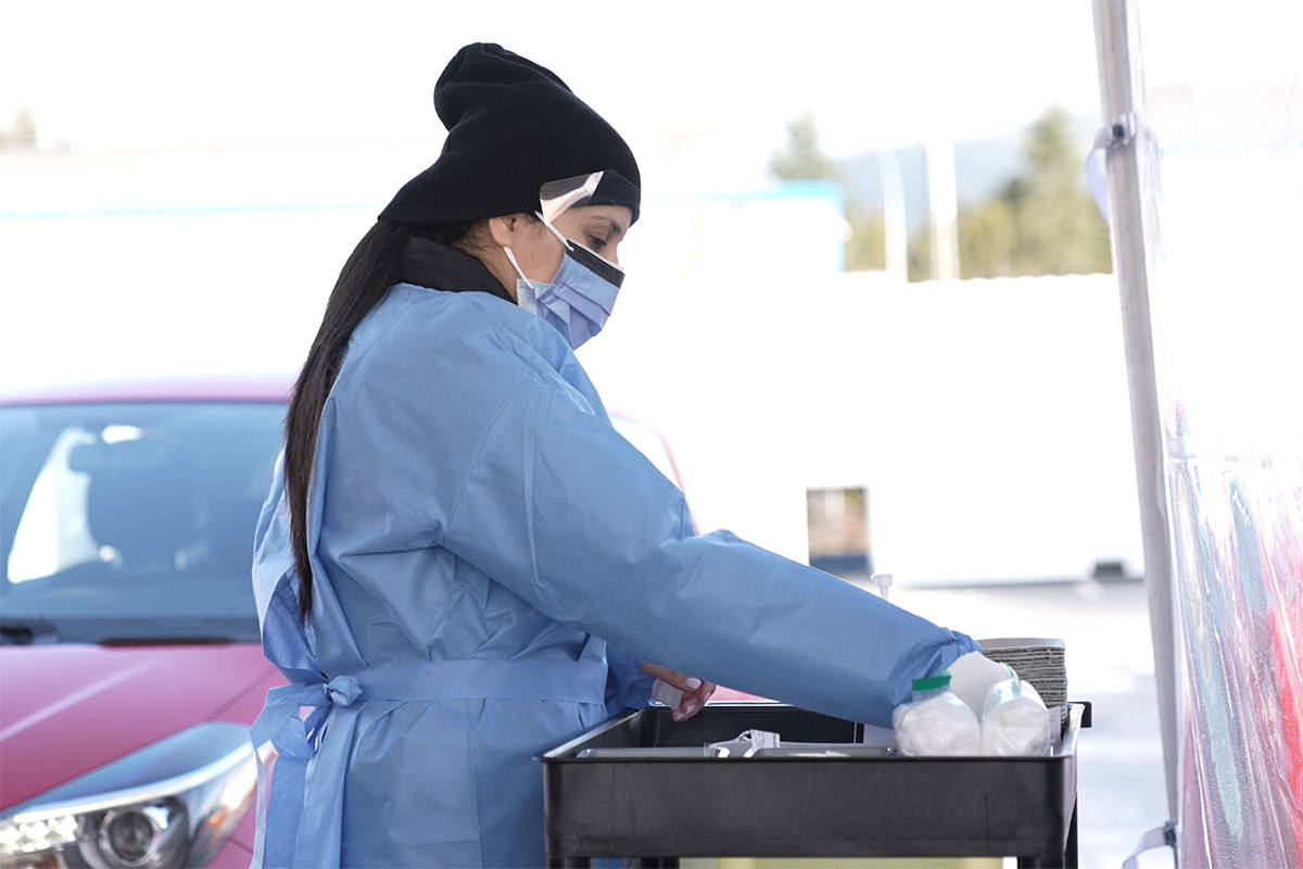A nurse prepares to vaccinate healthcare workers at a COVID-19 drive-thru immunization site in Coquitlam in this image supplied to the media by Fraser Health on March 8, 2021. (Fraser Health)
