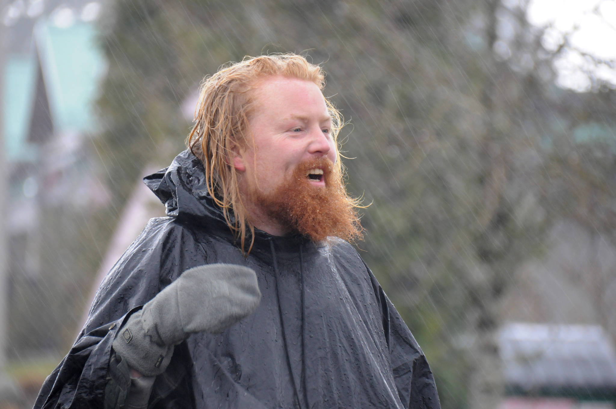 Michael Yellowlees of Dunkeld and Birnam, Scotland, arrives in Port Alberni during a typical southeaster storm, Friday, March 5, 2021. Yellowlees and his husky dog Luna will be walking across Canada to raise funds for Trees for Life, a Scottish charity. (SUSAN QUINN/ Alberni Valley News)