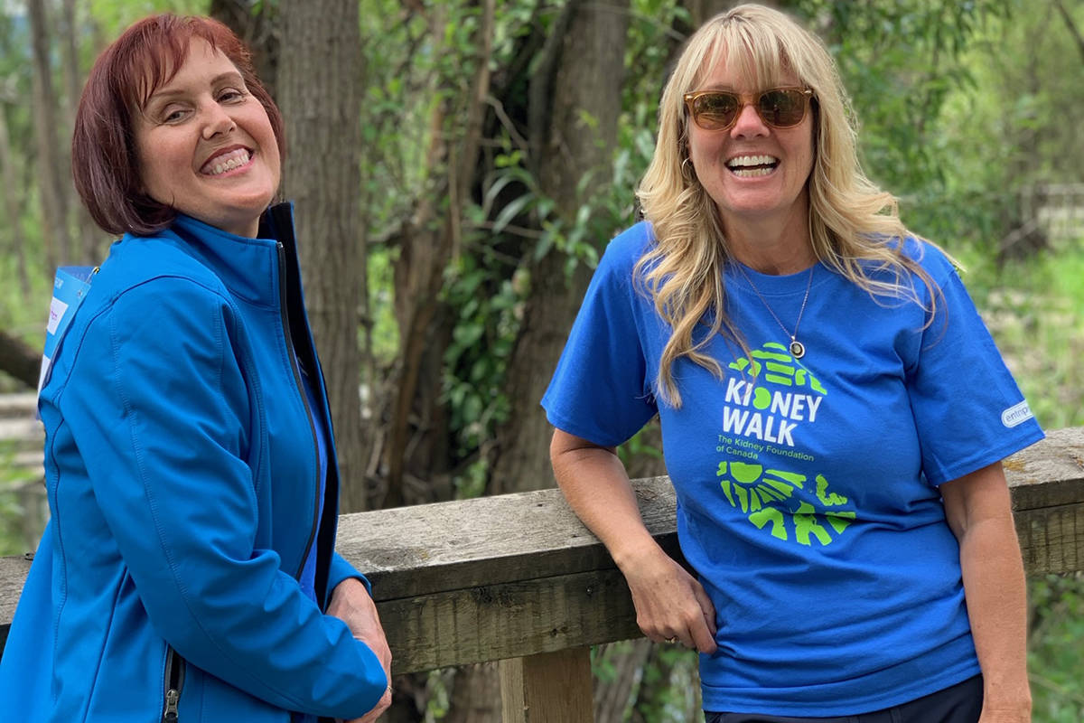 Vernon's Jacqueline Marioni (left) is joined by childhood friend Barb Statton for a photo in Polson Park as the pair take a breather from their virtual Kidney Walk around the park Sunday, June 7. Marioni, a two-time kidney transplant recipient, raised $6,000 for the annual event. (Photo submitted)