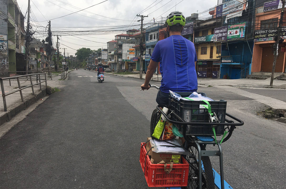 To stop the spread of COVID-19, Nepal banned vehicles. So, Travis Wilkins, who owns a juice factory in the country, delivered his product by bicycle. (Submitted)