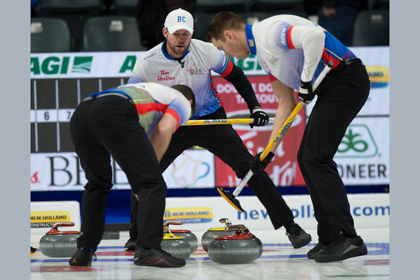 Vernon's Jim Cotter (centre) and Kelowna's Rick Sawatsky (left) and Andrew Nerpin follow a Steve Laycock shot into the house at the 2021 Tim Hortons Brier Canadian men's curling championships in Calgary. Team B.C. fell to 1-4 Tuesday, March 9, with a 4-3 loss to Wayne Middaugh's Ontario Wild Card 3 foursome. (Michael Burns Photography)