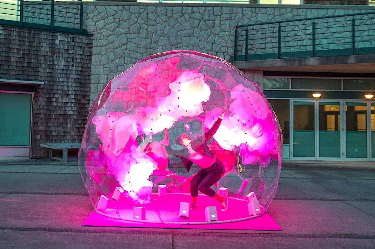 "Jeanette Kotowich, a Cree dancer, performs inside a newly-installed ""dance bubble,"" part of Tourism Vancouver's latest effort to draw locals back to the downtown core. (Small Stage)"
