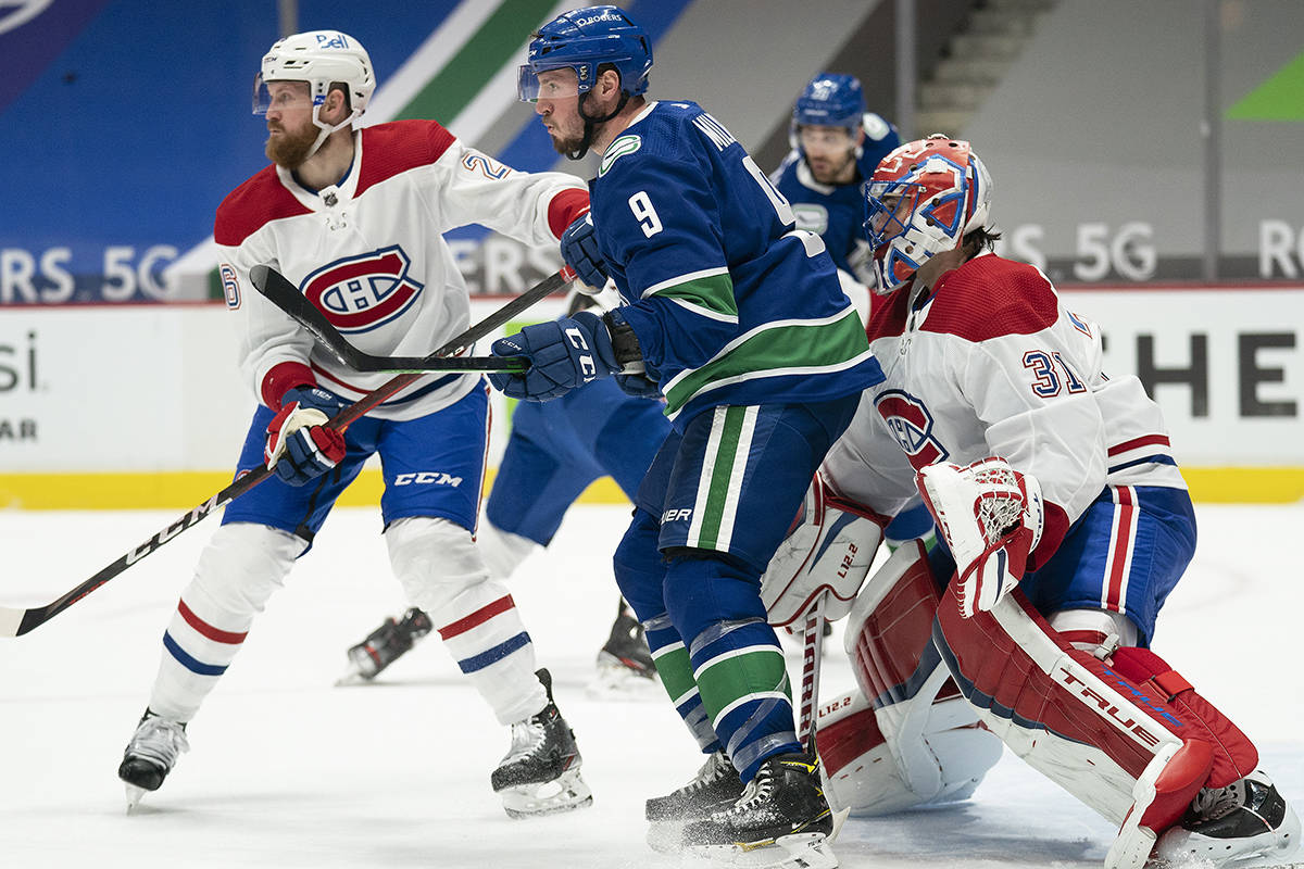 Montreal Canadiens defenceman Jeff Petry (26) tries to clear Vancouver Canucks centre J.T. Miller (9) from in front of Montreal Canadiens goaltender Carey Price (31) during second period NHL action in Vancouver, Wednesday, March 10, 2021. THE CANADIAN PRESS/Jonathan Hayward