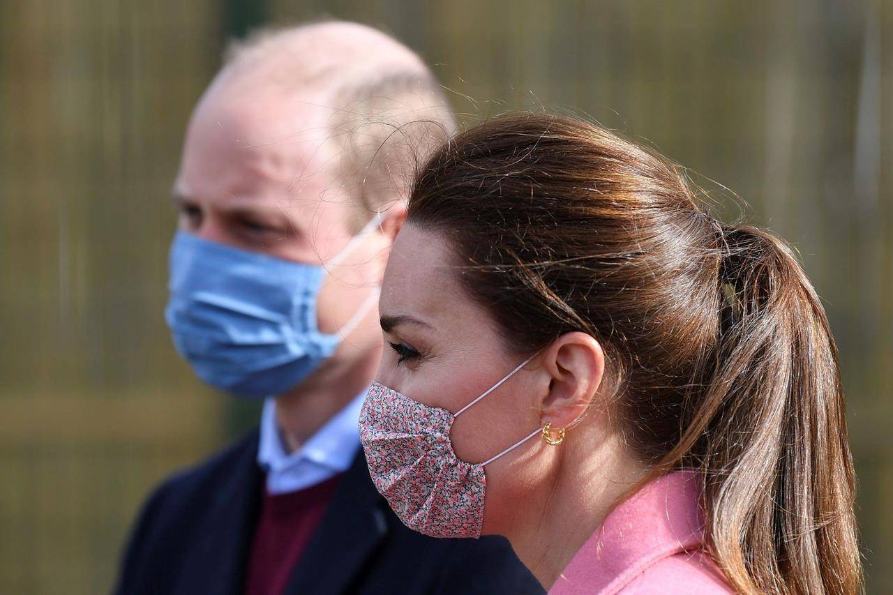 Britain's Prince William and Kate, Duchess of Cambridge arrive for a visit to School21, a school in east London, Thursday March 11, 2021. (Justin Tallis/Pool via AP)