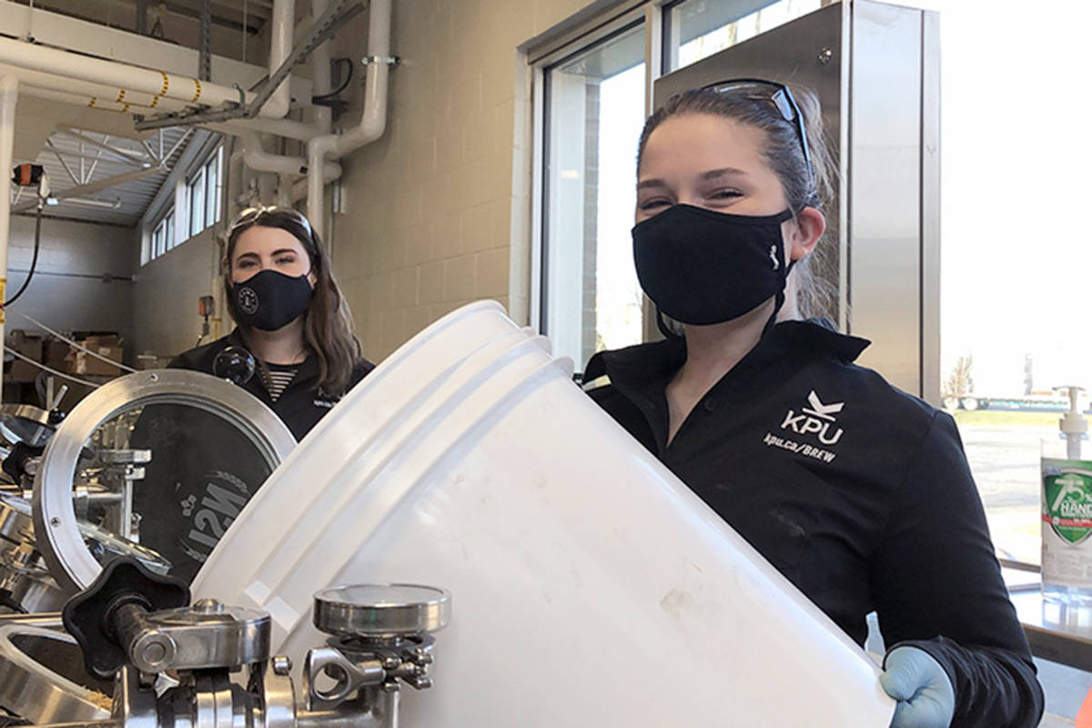 """Rebecca Deil (left) and Emily Comeau making the Pink Boots beer at KPU. Brewing was one of the programs that had to stay in """"on campus"""" mode during the COVID-19 pandemic. (KPU/Special to the Langley Advance Times)"""