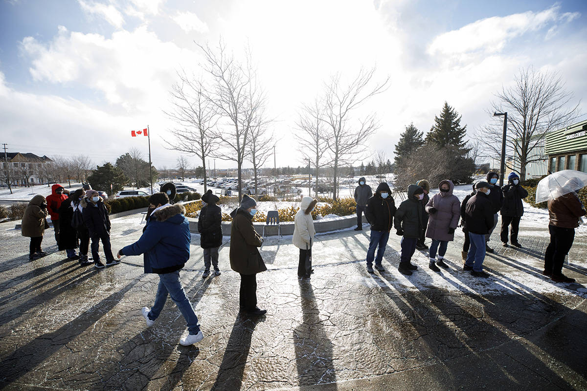 York Region residents wait in line for a COVID-19 vaccination at a mass vaccination site for residents 80 years and older, in Richmond Hill, Ont. on Monday, March 1, 2021. THE CANADIAN PRESS/Cole Burston