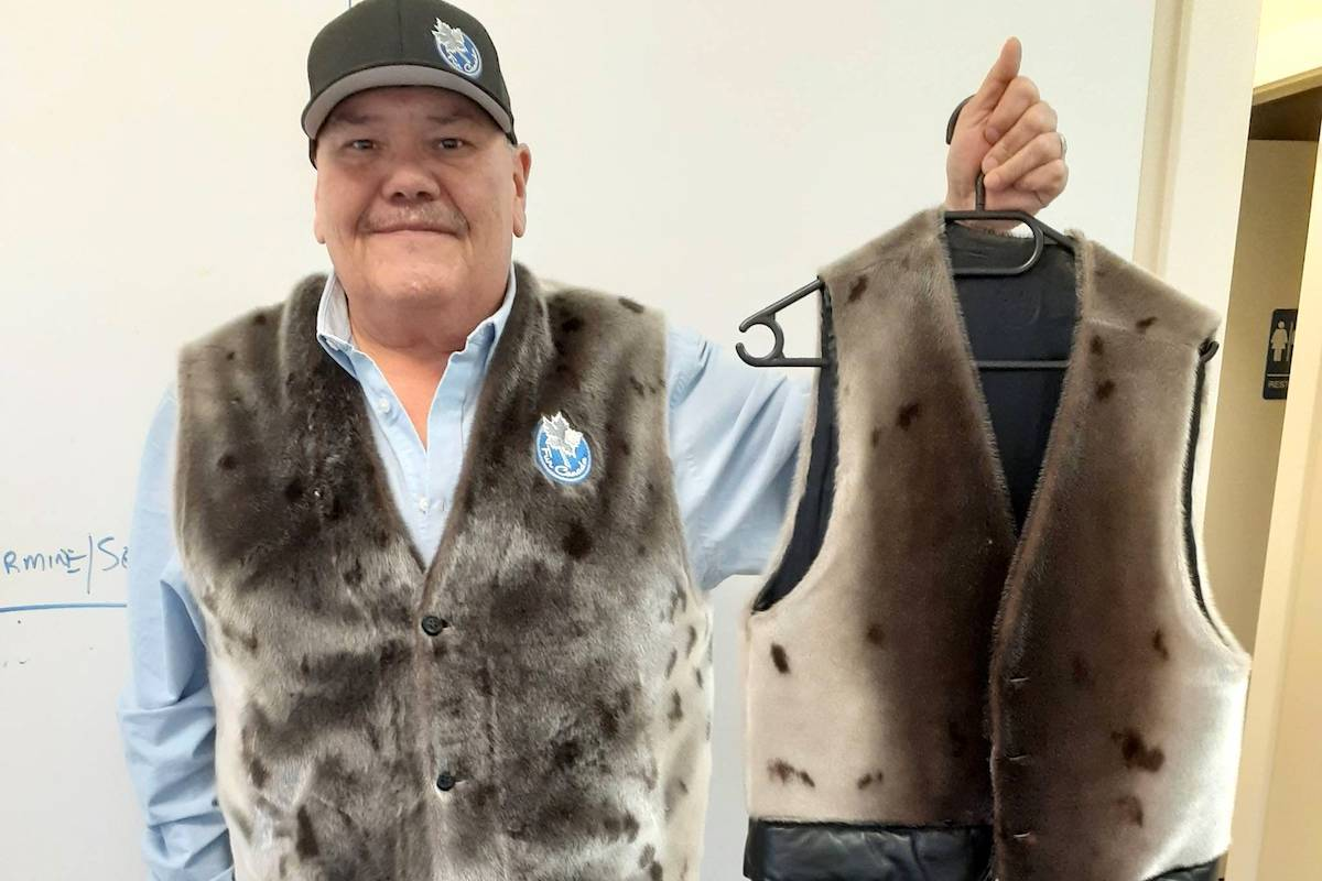 Tom Sewid, a long-time fisherman from Vancouver Island's Kwakwaka'wakw Nation, demonstrates some clothing products made from seals and sea lions. (Submitted photo)