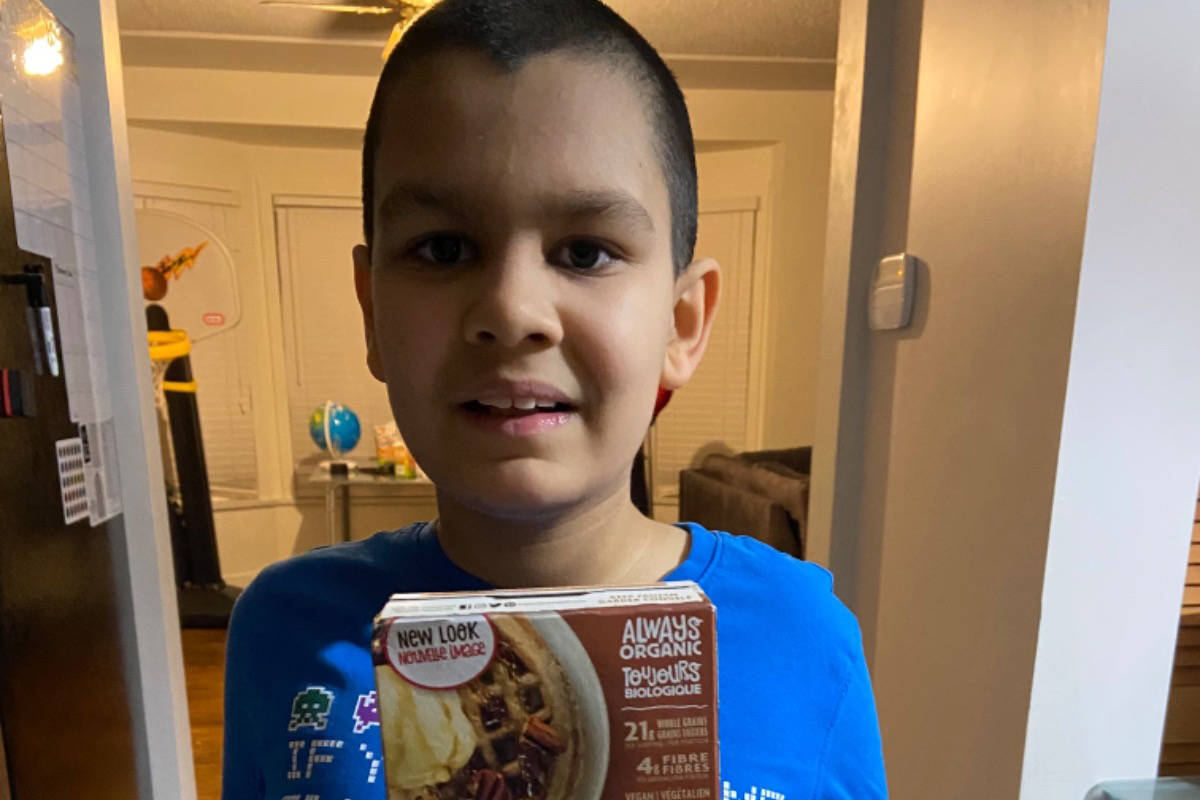 Jerico Roman with a box of the Nature's Path Maple Cinnamon Waffles he loves to eat. (Photo: GoFundMe)