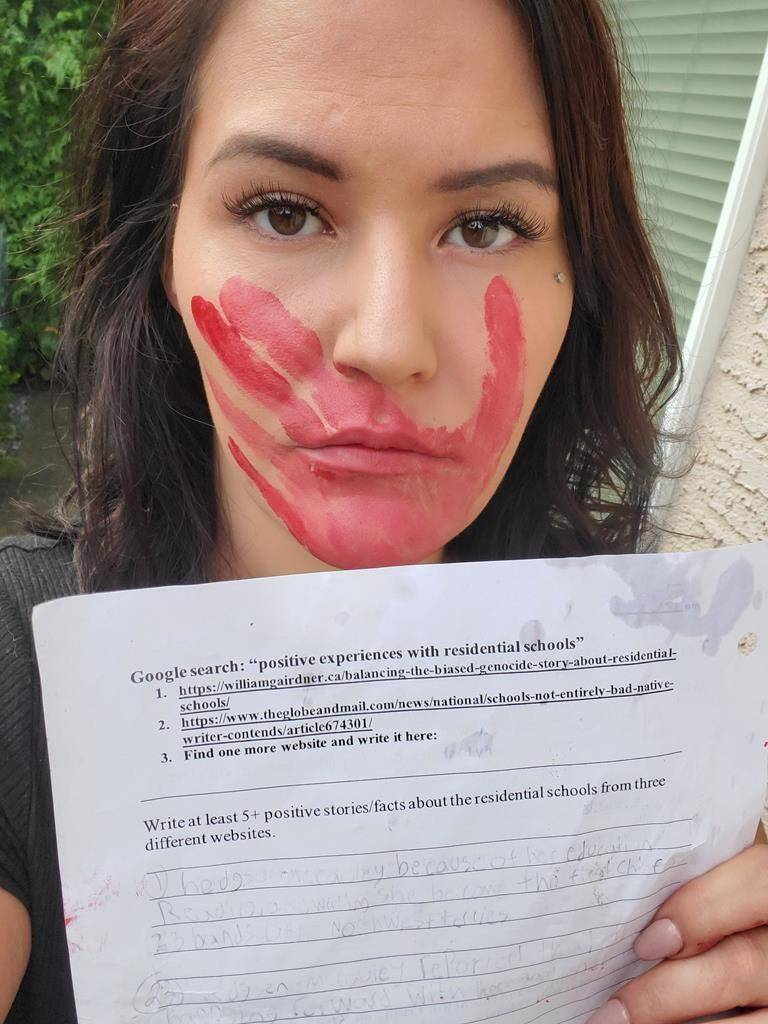 Krista Macinnis, with a red handprint across her face that symbolizes the silencing of First Nations people, in November displayed the homework assignment that her Grade 6 daughter received about residential schools. (Submitted photo)