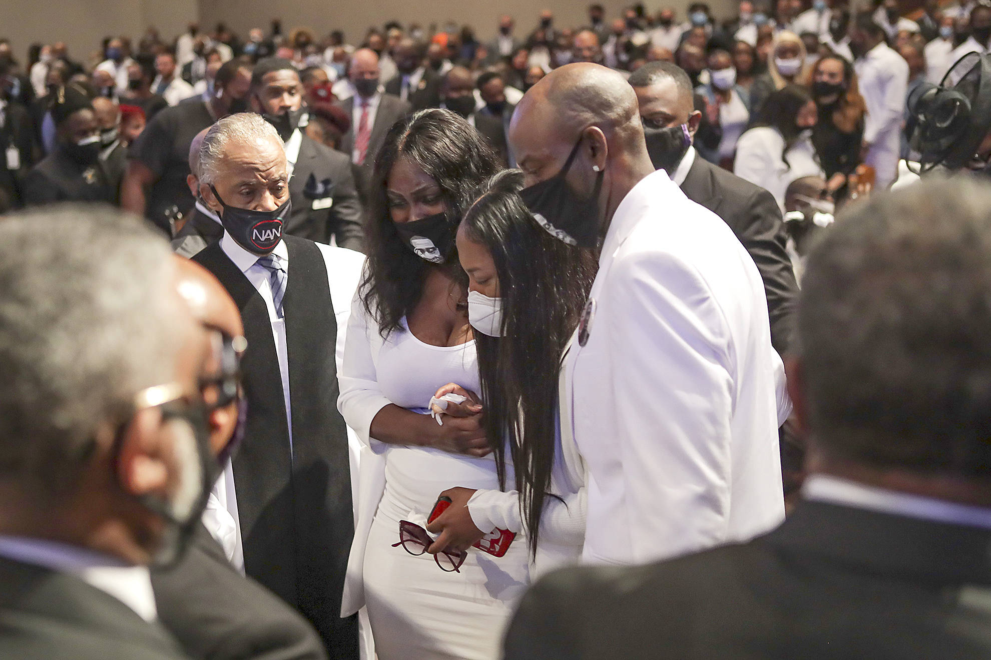 Family members react as they view the casket of George Floyd during the private funeral held Tuesday in Houston, Texas. (Godofredo A. Vasquez/Getty Images)