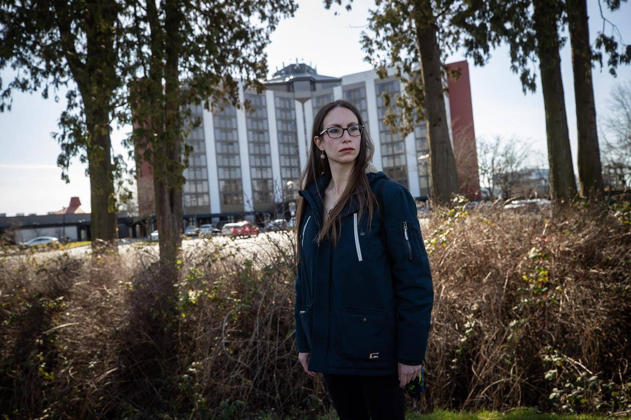 Elisa Cardona, who was laid off from her job at Pacific Gateway Hotel, poses for a photograph outside the hotel in Richmond, B.C., on Thursday, March 11, 2021. THE CANADIAN PRESS/Darryl Dyck
