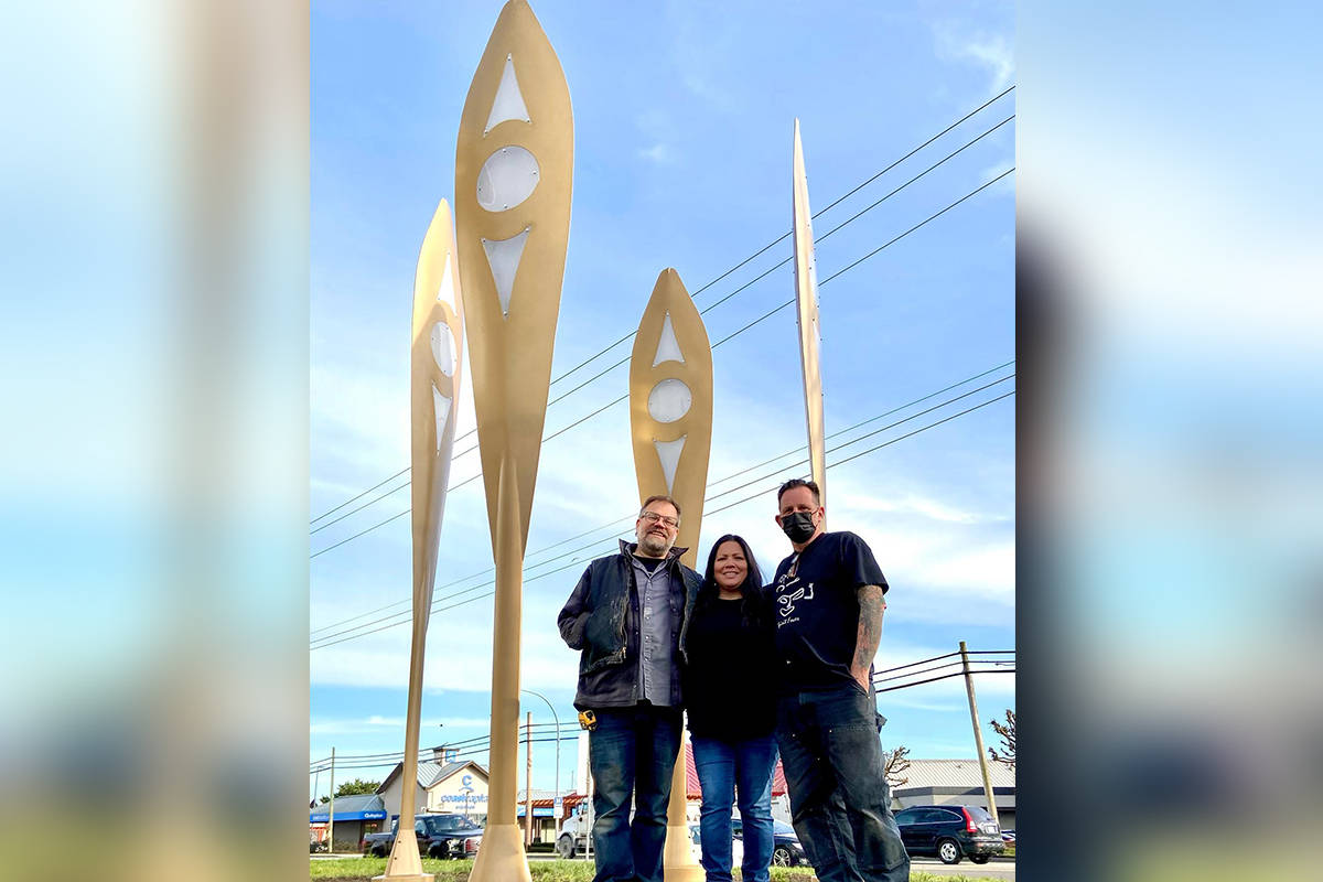 "Artists (from left) Aaron Jordan, Phyllis Atkins, and Drew Atkins stand in front of their new sculpture ""The Rivers that Connect Us"" at the Museum of Surrey. (Image via Facebook)"