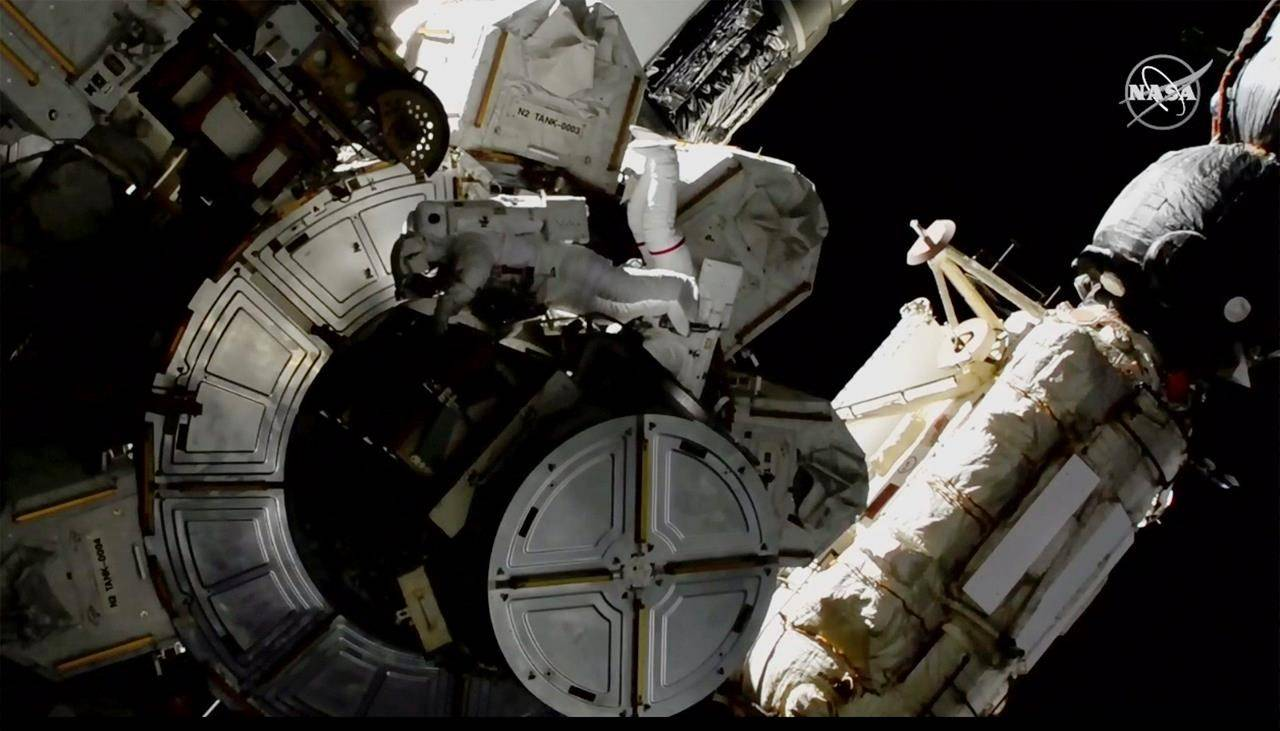 NASA astronauts Victor Glover and Mike Hopkins on a spacewalk outside the International Space Station on Saturday, March 13, 2021. (NASA via AP)