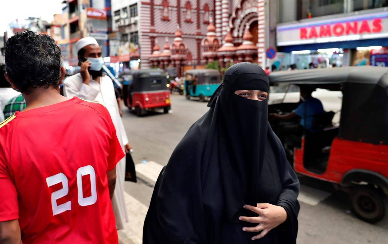 Sri Lanka on Saturday announced plans to ban the wearing of burqas and said it would close more than 1,000 Islamic schools known as madrassas, citing national security. (AP Photo/Eranga Jayawardena)