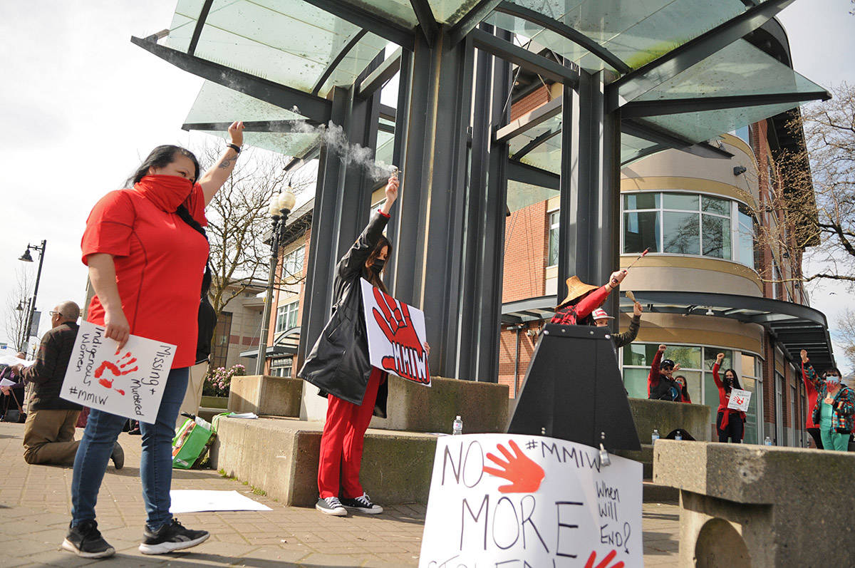 About 30 people gathered at Five Corners in Chilliwack on Saturday, March 13, 2021 for MMIW Takes Back Canada, a nationwide endeavour to draw attention to the issue of missing and murdered Indigenous women. (Jenna Hauck/ Chilliwack Progress)