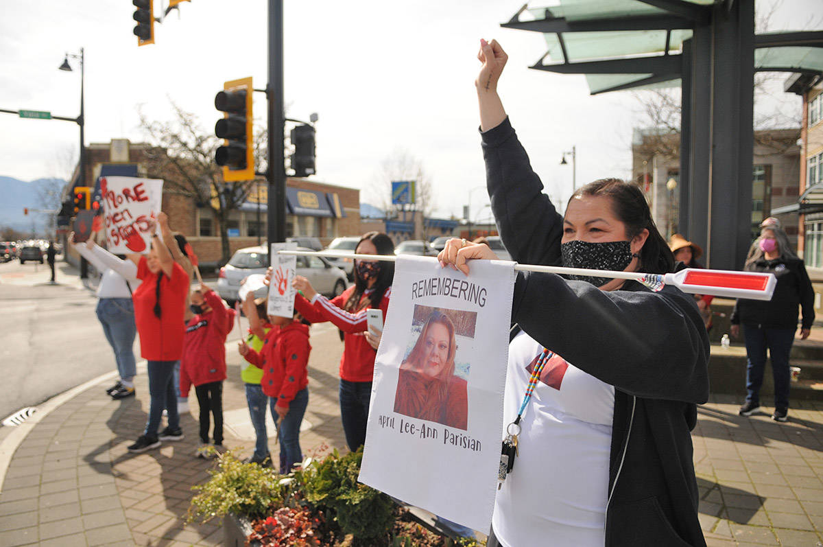 Dee Dee Peters, cousin of missing Hope woman April Parisian, was one of about 30 people who gathered at Five Corners in Chilliwack on Saturday, March 13, 2021 for MMIW Takes Back Canada, a nationwide endeavour to draw attention to the issue of missing and murdered Indigenous women. (Jenna Hauck/ Chilliwack Progress)