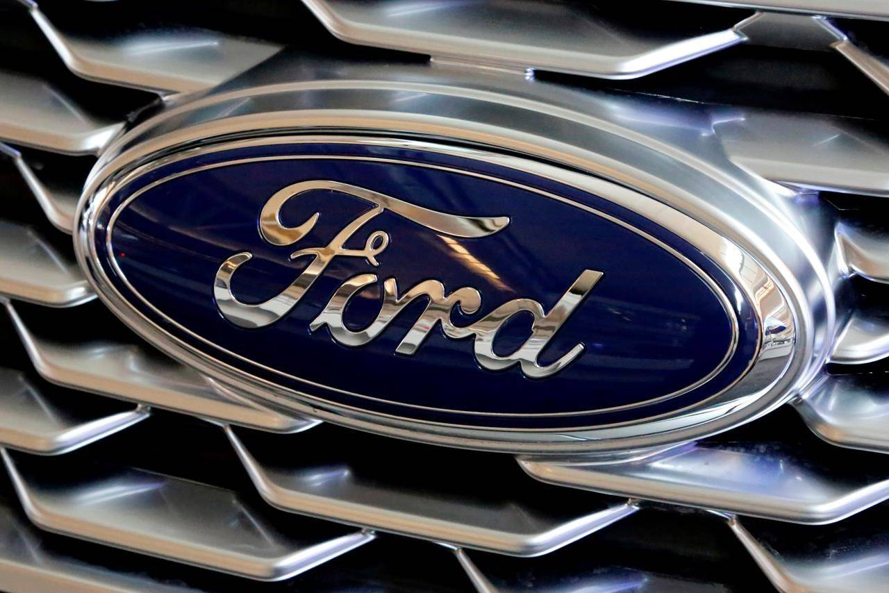 A Ford logo is seen on display at the Pittsburgh Auto Show on Feb. 15, 2018. THE CANADIAN PRESS/AP, Gene J. Puskar