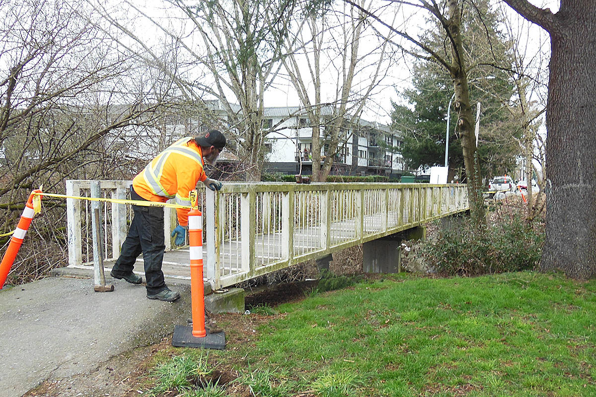 A 30-metre pedestrian bridge near 208th Street was lifted out by a crane and transported to a shop where old lead-based paint can be safely stripped off (Special to Langley Advance Times)