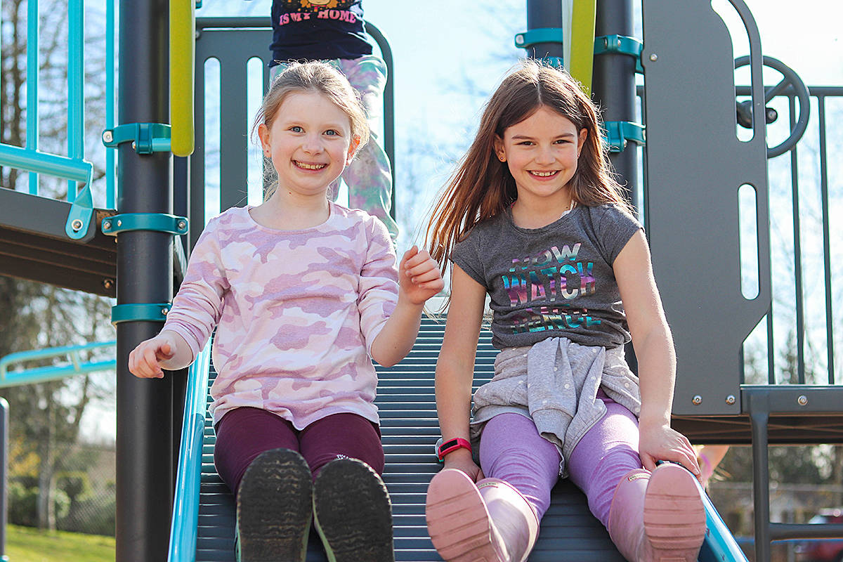 "Students at Langley's Topham Elementary School tried out the ""rolly"" slide in the new playground on Friday, Match 5. It was designed with input from students at the K-7 school in Walnut Grove. (Special to Langley Advance Times)"