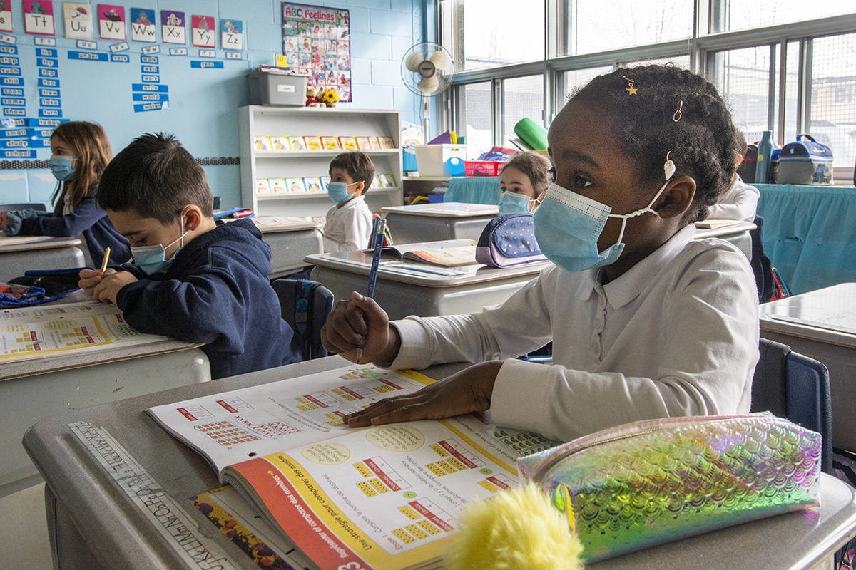 FILE – Grade one students wear masks as they attend class at Honore Mercier elementary school Tuesday, March 9, 2021 in Montreal.THE CANADIAN PRESS/Ryan Remiorz