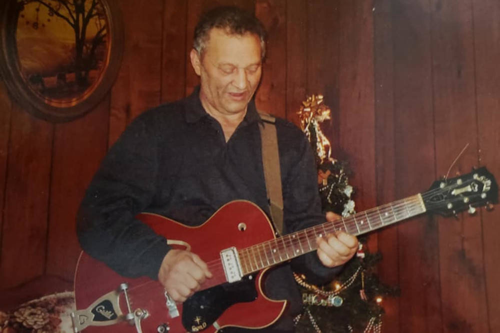 Michael Vecchio playing his cherry Guild Starfire at a family Christmas gathering in 2014. (Connie Vecchio photo)
