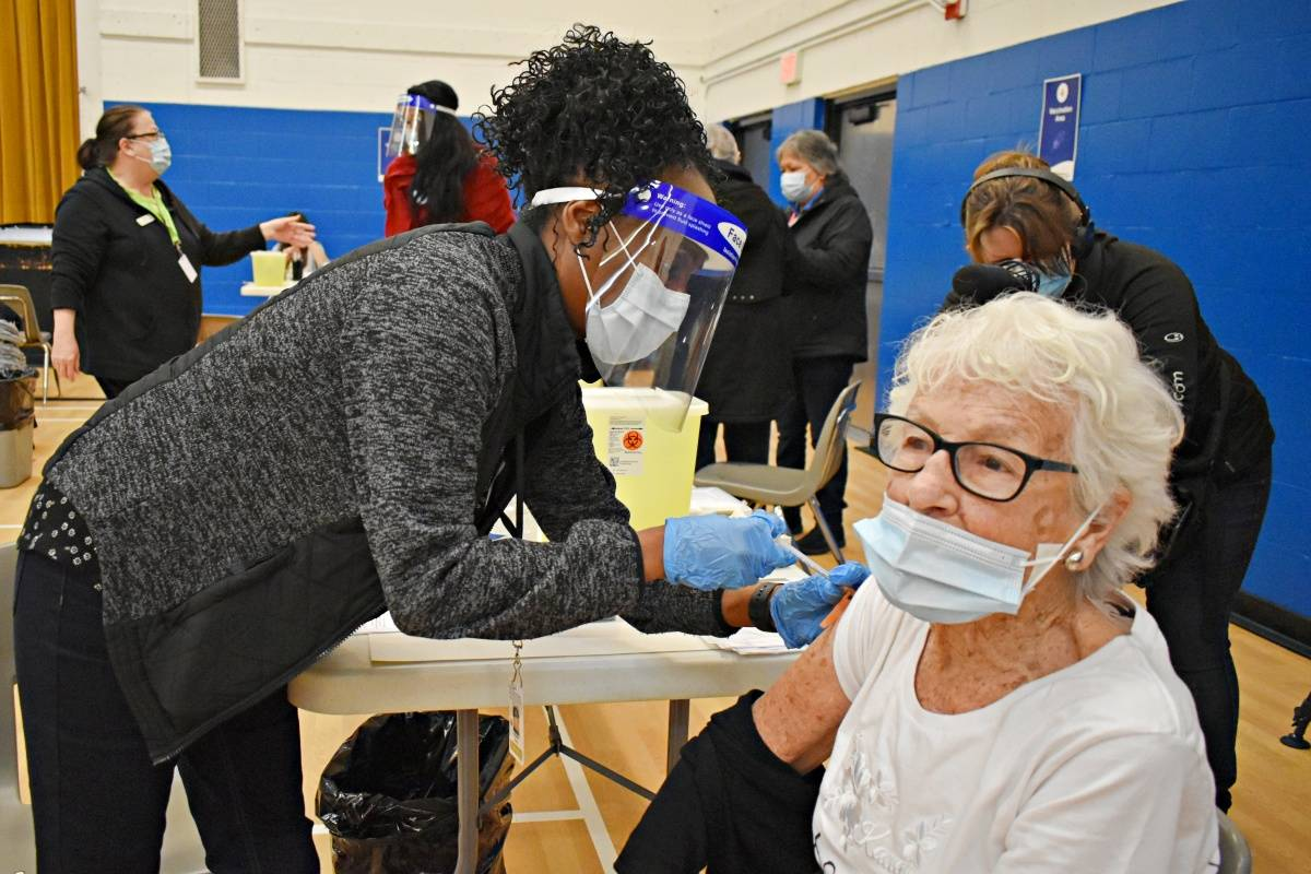 Charlotte Rowse, 96, is one of the first to be vaccinated at the community COVID-19 immunization clinic in Prince Rupert March 14. Community vaccination clinics have opened in communities across B.C. (Photo: K-J Millar/The Northern View)