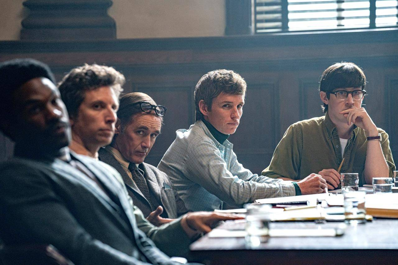 """This image released by Netflix shows , from left, Yahya Abdul-Mateen, Ben Shenkman, Mark Rylance, Eddie Redmayne and Alex Sharp in a scene from """"The Trial of the Chicago 7."""" (Niko Tavernise/Netflix via AP)"""