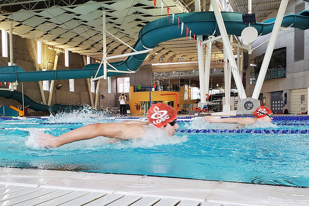 LOSC members Piyush Kaul and Bailey Herbert work out at the Walnut Grove pool in Langley on March 2, 2021. Parents say new Township fees have added as much as $160 a month in costs per child. (Sevi Parr/Special to Langley Advance Times)