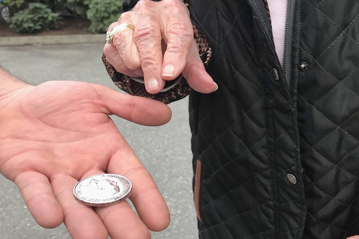 Medal found by metal detectors handed over to Chilliwack family of First World War nurse. (Jennifer Feinberg/ The Chilliwack Progress)