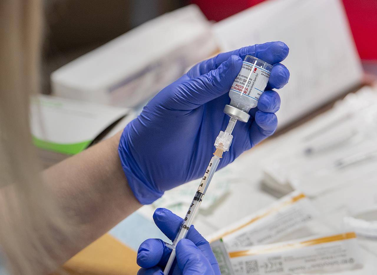 Amanda Parsons, a registered nurse, prepares a dose of the Moderna vaccine on January 11, 2021. THE CANADIAN PRESS/Andrew Vaughan
