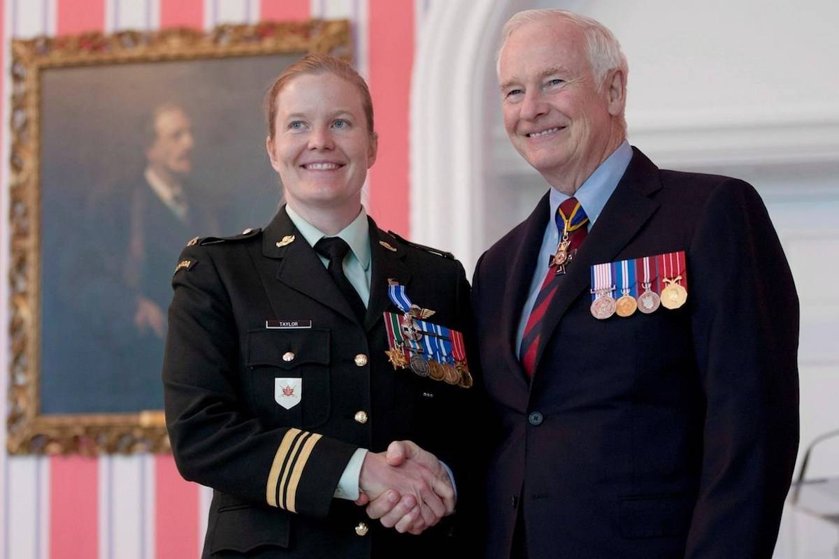 """Governor General David Johnston presents then Major Eleanor Taylor, from Antigonish, N.S., with the Meritorious Service Medal during a ceremony in Ottawa, Ont. Friday June 22, 2012. A female officer of the Canadian Armed Forces is quitting the military, saying she is """"sickened"""" by ongoing investigations of sexual misconduct against senior military leaders. THE CANADIAN PRESS/Adrian Wyld"""