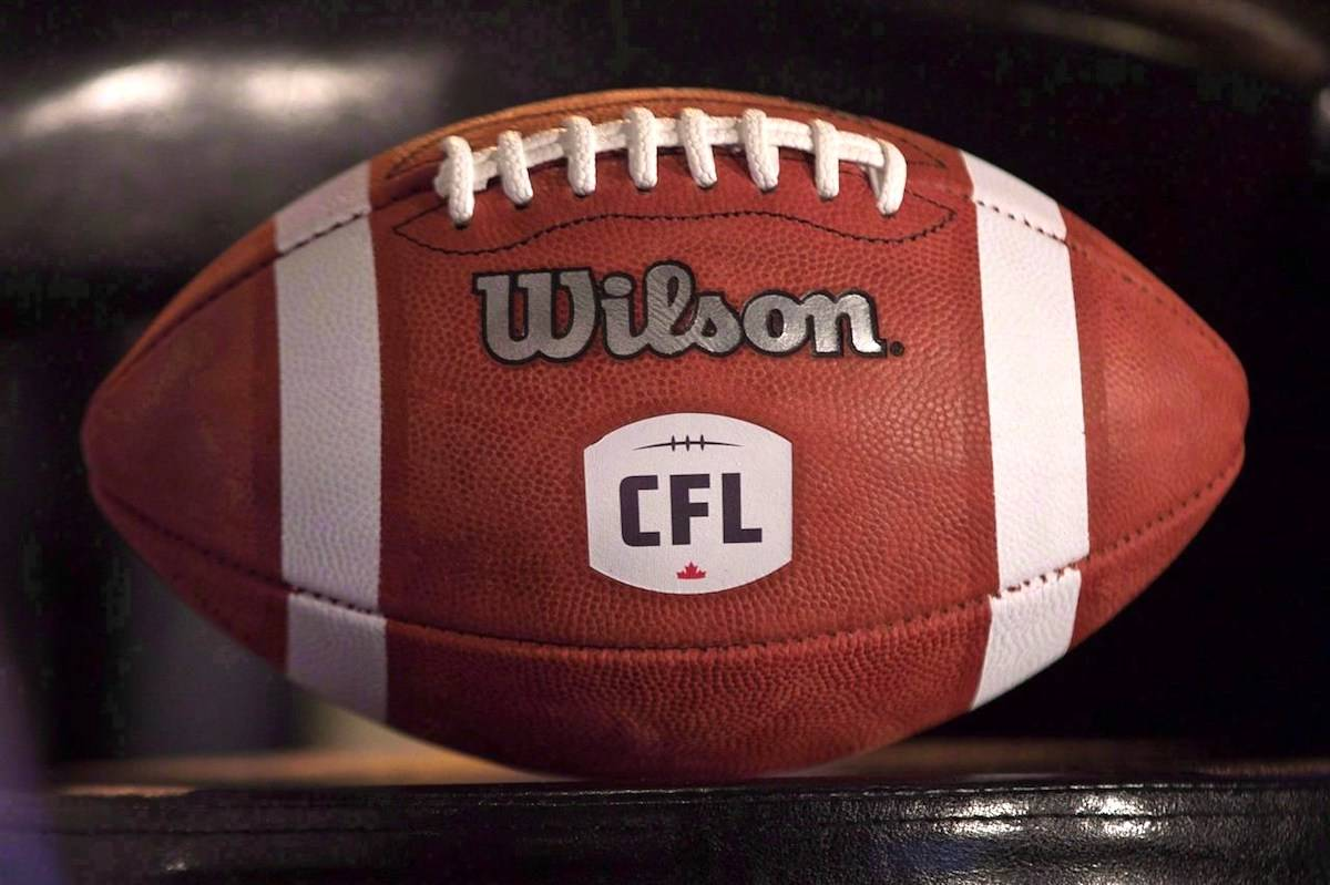 A football with the CFL logo sits on a chair during a press conference in Winnipeg, Friday, November 27, 2015. The CFL denied a social media claim from the United Football Players Association suggesting the league will likely cancel its 2021 and '22 seasons. THE CANADIAN PRESS/John Woods