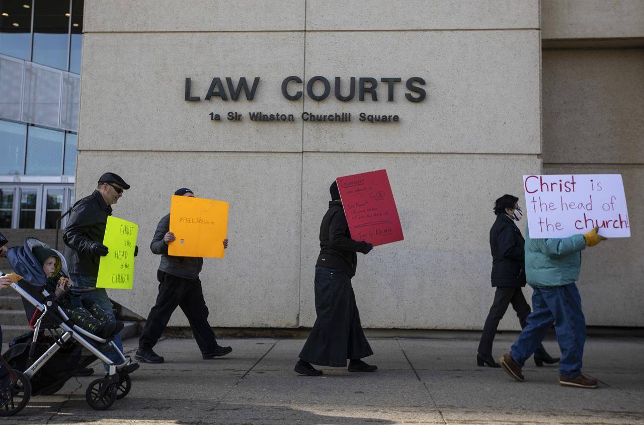 Supporters rally outside court as Pastor James Coates of GraceLife Church appeals his bail conditions In Edmonton on Thursday March 4, 2021. THE CANADIAN PRESS/Jason Franson