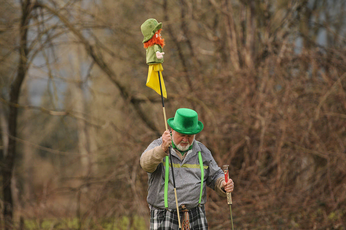 Patrick O'Shea puts his leprechaun golf head cover atop the 13th flag during a round of golf at Meadowlands Golf and Country Club on St. Patrick's Day on March 17, 2021. (Jenna Hauck/ Chilliwack Progress)