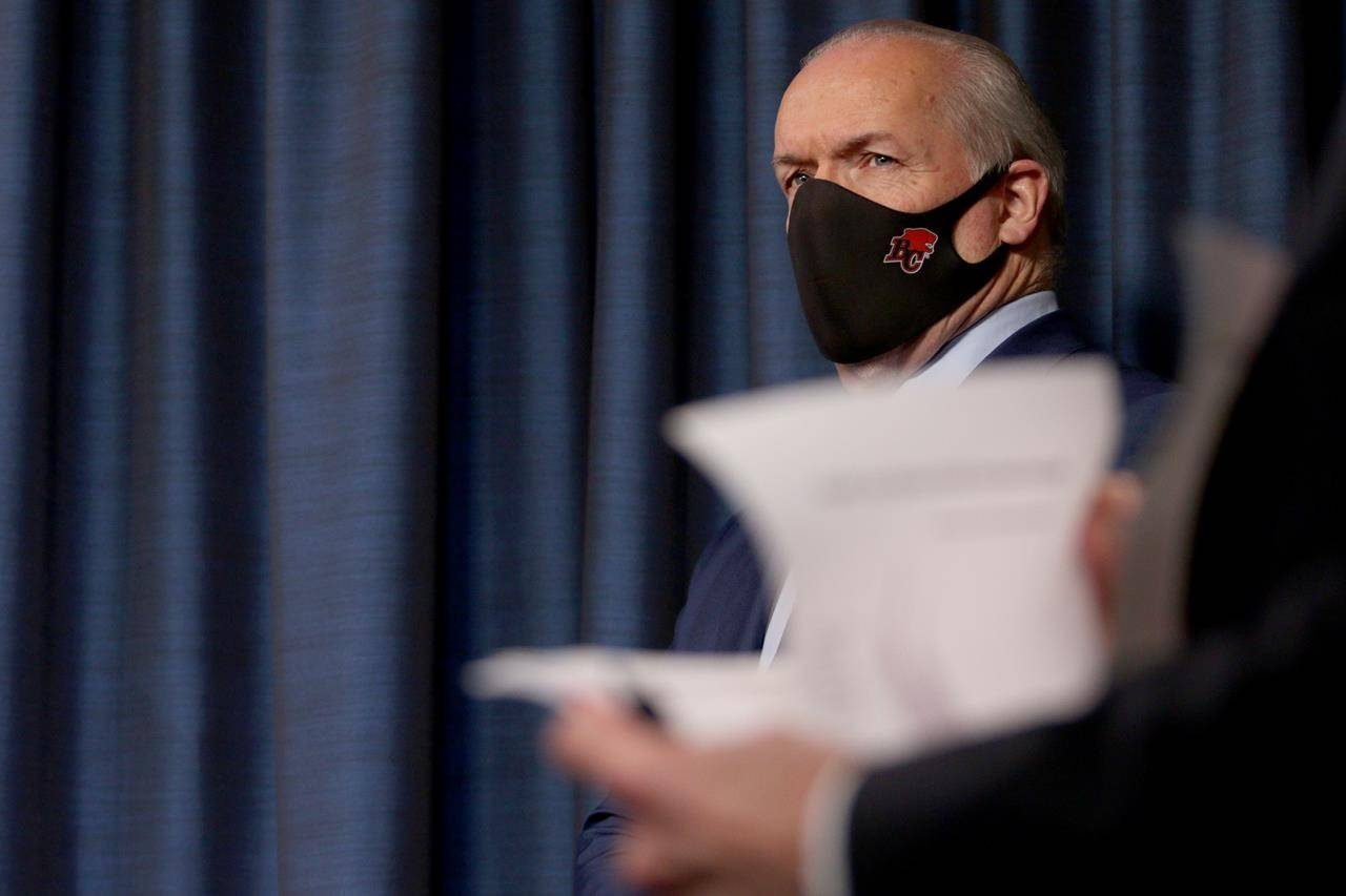 Premier John Horgan looks on during a news conference at the legislature in Victoria. THE CANADIAN PRESS/Chad Hipolito