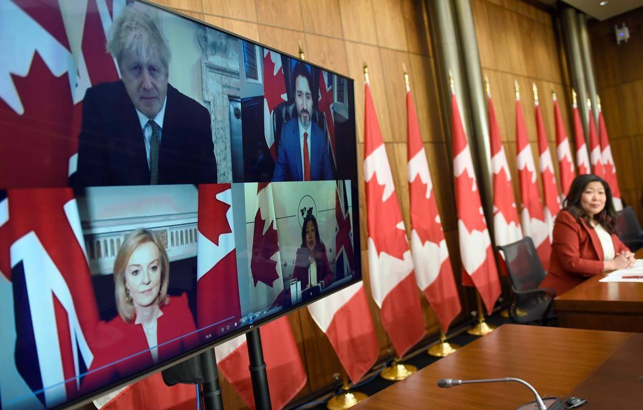 Canadian Prime Minister Justin Trudeau, U.K. Prime Minister Boris Johnson and International Trade Secretary  Liz Truss, during a news conference on the Canada-United Kingdom Trade Continuity Agreement in Ottawa, on Saturday, Nov. 21, 2020. THE CANADIAN PRESS/Justin Tang