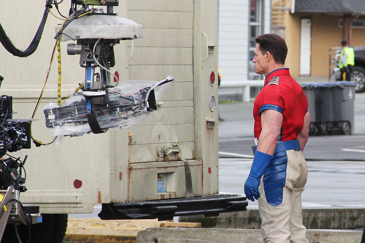 John Cena takes his mark on the ground after a stuntman jumped from the second floor of the Dann's Electronics building in Cloverdale March 19. (Photo: Malin Jordan)