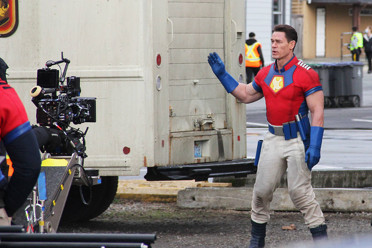 """Professional wrestler and actor John Cena talks to a camera operator while filming the second part of a jump scene in Cloverdale March 19 for the new series """"Peacemaker."""" Cena is starring in the title role. See Page 3 for more photos. (Photo: Malin Jordan)"""