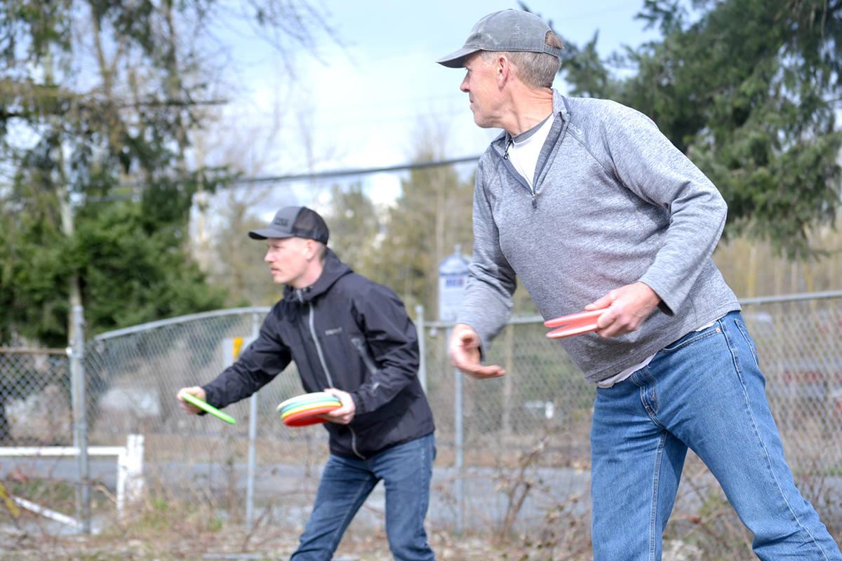 Father and son, Ian and Ethan, toss discs at Aldergrove's Raptors Knoll course. (Ryan Uytdewilligen/Aldergrove Star)