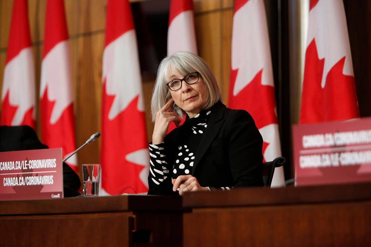 Health Minister Patty Hajdu listens at a COVID-19 press conference in Ottawa, Friday, Dec. 11, 2020. An interim examination of why the federal government's pandemic early warning system failed to send up a formal alert on COVID-19 has been released. THE CANADIAN PRESS/David Kawai
